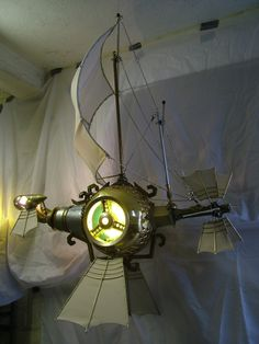 Steampunk Galleon made from bits of junk from a scrapyard for an American company about 2008. It's a 3d model of their flash animation logo. By Hubcap Creatures
