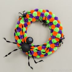 Say boo! This pom-pom Halloween wreath is easy-to-create and oh so friendly!