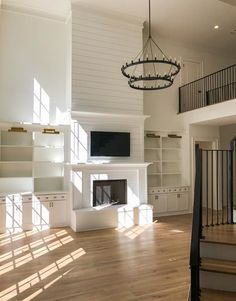 Living Room tall shiplap Built-ins add to the livability to the space while a ta. Living Room tall shiplap Built-ins add to the livability to the space while a tall fireplace balanc Tall Fireplace, Fireplace Built Ins, Fireplace Remodel, Fireplace Design, Fireplaces, Fireplace Ideas, Two Story Fireplace, Cabin Fireplace, Fireplace Doors