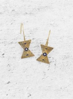 Gold plated earrings with navy blue enamel settings