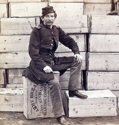 """Even 50 lbs. of Army food could be really HARD ... """"Hard Tack"""" From a stereograph showing Union Captain J. W. Forsyth, the Provost Marshall, sitting on a crate of hardtack, a cracker like bread served to soldiers, at Aquia Creek, Virginia. Crate says """"50lbs. net. Army Bread from the Union Mechanic Baking Company, 45 Leonard St."""" https://www.loc.gov/resource/stereo.1s02737/"""