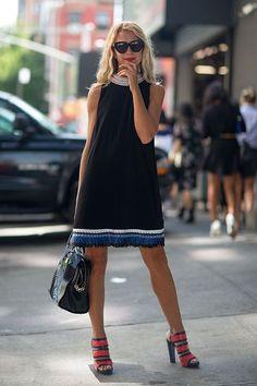 Natalie Joos in black shift dress with colorful neckline & hem #NYFW | Street Style New York #Fashion Week Spring 2014 #spring2014