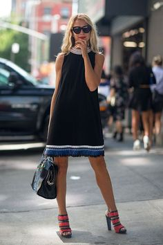 Natalie Joos in black shift dress with colorful neckline & hem #NYFW | Street Style New York #Fashion Week Spring 2014 #spring2014  Highlight Description Natalie Joos in black shift dress with colorful neckline & hem #NYFW | Street Style New York #Fashion Week Spring 2014 #spring2014