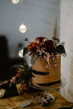 nearly-naked chocolate cake with fresh flowers