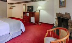 Deluxe King Room with Fireplace - Spacious and comfortable guest-room with 1 king bed, fireplace and private balcony!