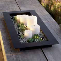 A Zen inspiration in indoor-outdoor decoration. This simple, watertight tray is the foundation for a reflecting pool with or without rocks, floating candles or blossoms like a succulent garden. Perfect for the ecofriendly wedding registry. | Reflection Black Metal Centerpiece from @crateandbarrel #weddingregistry