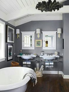 Relaxing Color Scheme  Cool Gray + Crisp White  Contrast is the name of the game in this bathroom, where cool gray walls mingle with crisp white trim and furnishings. The rich wall color creates a luxurious environment that's perfect for relaxing after a long day. Shimmering chrome fixtures echo the wall color.