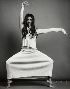 As you've never seen her before: Victoria Beckham proved that she had an extremely silly side as she let her hair down in a series of exquisite portraits for Vogue China