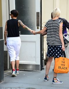 Ruby Rose's fiancee steps out with star carrying an OITNB bag
