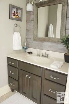 Bathroom - Really like the reclaimed wood on the wall, would love to use this idea with a mirror framed with white molding instead of reclaimed wood.