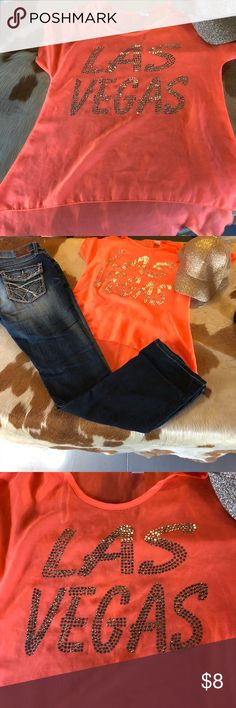 Las Vegas sheer glitter shirt This is a good condition high low size small sheer top it is bright orange in color with Las Vegas in gold glittery stones One Fashion Tops Blouses