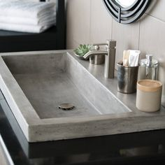 This NativeStone Collection trough bath sink from Native Trails is made with a special formula of cement and jute fiber that makes it 40% lighter than traditional concrete. The special formula makes the sink scratch, crack and stain resistant. Available in ash, pearl and slate finishes, this natural bathroom sink is a beautiful focal point in any remodel.