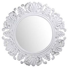 "Add a touch of drama to your entryway or living room with this eye-catching wall mirror, featuring a scrolling frame in glossy white.  Product: Wall mirrorConstruction Material: Metal and mirrored glassColor: White frameDimensions: 44"" Diameter"