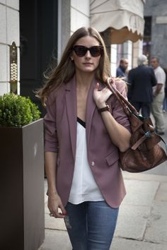 Olivia Palermo wears the Zagliani Gatsby Tote in  tobacco-hued crocodile lined with stained turquoise.