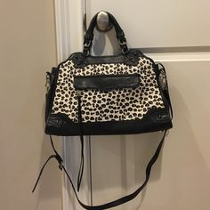 Animal print/ black Rebecca Minkoff handbag Gorgeous, great condition, authentic Rebecca Minkoff shoulder bag/ cross body bag. Smaller handles and longer strap. Tassel and spike detailing. Lots of pockets. Top zip. Rebecca Minkoff Bags Crossbody Bags