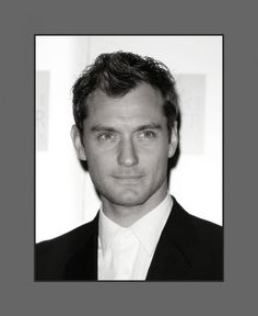 Jude Law's hair is cut in layers short on the side and longer in top and styled with a soft wave covering a little of the forehead  - 2013 Hairstyles for Men with Balding Thinning Hair Style Cuts Trends