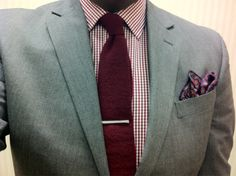 Grey Kenneth Cole suit, red plaid shirt, red knit tie, blue and red pocket square, tie bar and cap-toe oxfords.