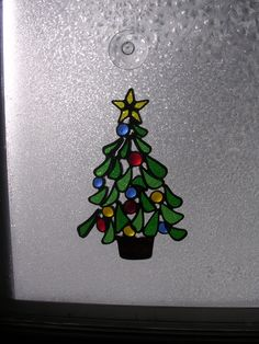 Stained glass Christmas tree by TinseysWhimseys on Etsy https://www.etsy.com/listing/203171387/stained-glass-christmas-tree