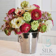 """$138.60  Garden Flowers In Vase 13''          Fresh from the garden- ranunculus, hyacinths, poppy anemones and viburunum are gathered together in this classic silver metal vase with side handles, 13"""" tall and 12"""" diameter"""