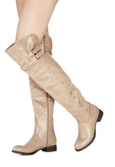 If you love a classic, you're going to love Coremma. A tall boot with side studded detailing, adjustable buckle strap at shaft, and a low block heel.  It's classically casual. Functional inner zip....