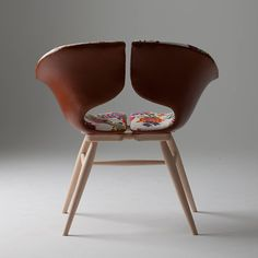 Leather Chair by Tortie Hoare: An inviting seat upholstered in floral linen & leather.