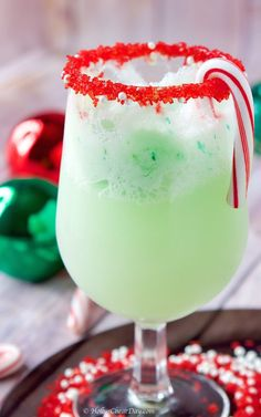 The Grinch Cocktail. Fun and festive this Grinch Cocktail is filled with Vanilla Vodka Lime Sherbet and Lemon Lime Soda. Christmas Drinks Alcohol, Christmas Cocktails, Holiday Drinks, Grinch Drink, Grinch Party, Xmas Party, Lime Sherbet, Banana Coffee, Vodka Lime