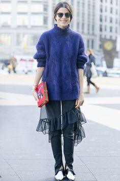 "Leandra Medine's latest ""man repelling"" mix-up features a dress over pants #streetstyle #NYFW"
