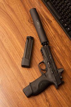 Smith & Wesson M&P handgun w/ suppressor Weapons Guns, Guns And Ammo, Glock 9 Mm, Rifles, Custom Guns, Military Guns, Military Life, Fire Powers, Smith Wesson
