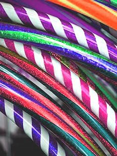"""[Hooping.org Columnist Shannon Loucks loves them all.] by Shannon Loucks My sister recently asked me, """"How many hula hoops do you have?"""" It was the …"""