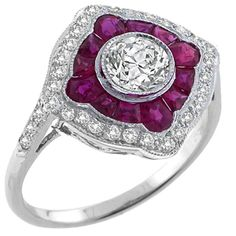 Art Deco Style ruby and 18kt white gold ring with a 0.70ct Old Mine Cut Center Diamond. Beautiful.