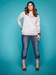 Plus size model Ashley Graham wearing the sequin and pearl sweatshirt and Suko jeans. Available at Addition Elle.