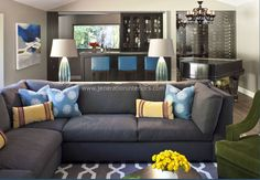 grey carpet with grey couch.  Loden green accent chair with the blue pillows #goodhousekeeping #happyroom