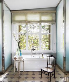 Love this window-side bath with it's outdoor green curtain!