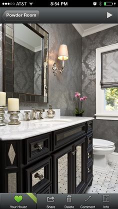 Powder room wallpaper; shiny silver, gray, black. white crown molding.  white marble vanity. espresso cabinet