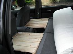 One side sits on the headrest and the other on the hinged legs.