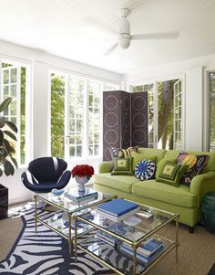Eclectic Family Room Jonathan Adler designed a sunny sitting area that's a modern take on the screened porch, with an eclectic mix of prints, colors, and styles. Featured in May 2009.