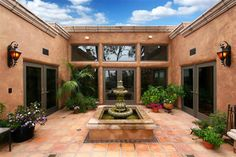 3 sets of French doors lead to the outside courtyard, complete with outdoor dining and BBQ area.
