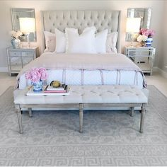 Bedroom ideas, bedroom decor, bedroom inspiration, neutral glam bedroom, tufted bed, mirrored furniture nightstand, classic gray paint Benjamin Moore, Chantilly Lace paint on trim, pink peonies, ginger jars, tufted bench, pink duvet, white bedding