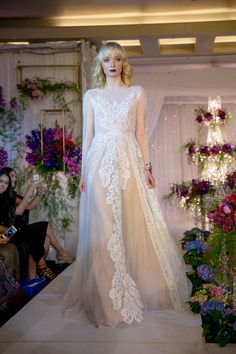 Illusion long sleeved wedding dress with nude tulle and white lace // Stepping Into a Wedding Wonderland: The Bridal Bazaar - Part 2 {Facebook and Instagram: The Wedding Scoop}