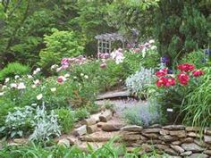 Love the rocks and the wildness. Yea, for English gardens.