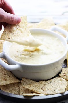 Cheesy Slow Cooker Queso Blanco Dip with green chili's. This recipe is so easy to make and is an instant party pleaser! Recipes With Velveeta Cheese, Cheese Recipes, Appetizer Recipes, Appetizers, Slow Cooker Recipes, Crockpot Recipes, Cooking Recipes, Yummy Eats, Yummy Food