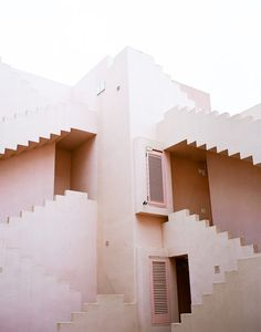 I really like the pastel pink colour of this building, and the way the stairs are positioned. (Pinned by: Christina Pasceri)