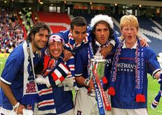 Gabriel Amato, Derek McInnes, Giovanni Van Bronckhorst, Lorenzo Amoruso and Colin Hendry celebrate winning the Scottish cup 1-0 against Celtic in 1999 to clinch the treble.