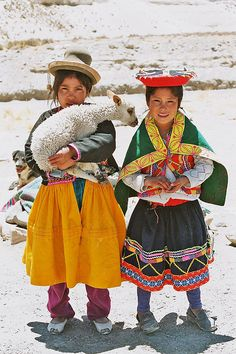 Peruvian girls. It's amazing how many indigenous people still dress this way—all over South America (Ecuador, Bolivia). I LOVE the culture in Peru. :)