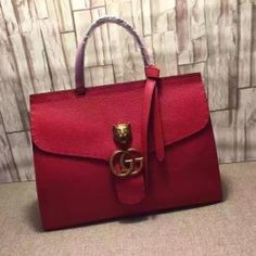 Gucci GG Marmont leather top handle bag red