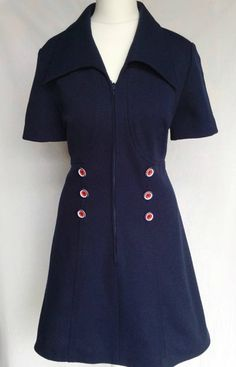 ✧Fab vintage 1960s-1970s Mod Northern Soul Navy Blue crimplene Scooter Mini Dress ... Very Twiggy in style! ✧Short sleeve bodice features an oversized Dagger collar with amazing ultra MOD red, white & Blue button detailing at waist, Flattering empire line waist, flowing through to an A line mini skirt ✧ Zips through the front ✧ Clean & ready to wear. Great dress for Day or Night! Description >Fits like a: Approx Size= Small-Medium or Approx Modern Day Size: UK 10 &#x...