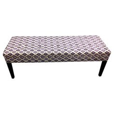 Made in the USA, this chic bench features ikat diamond upholstery and fire-resistant foam cushioning.   Product: Bench...