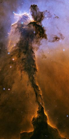 A view of the stellar spire within M16, the Eagle Nebula. It is approximately 9.5 light-years or about 90 trillion kilometers long! (9.5 light years or 5,878,625,370,938.2550123136 miles!)