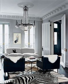 "Home interior - living room area - TREND ALERT: layering rugs is the new ""thing"""