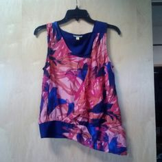 Anthro Leifsdottir Abstract Print Asymmetric Top Leifsdottir brand from Anthropologie, size 0, in excellent condition! This unique top features and red and pink abstract print and solid blue back. The front I'd a partial wrap and the bottom hem is an asymmetrical cut. Sleeveless and can be dressed up or down. Please ask any and all questions before purchasing. No trades. Make a reasonable offer. Thanks! Anthropologie Tops Tank Tops